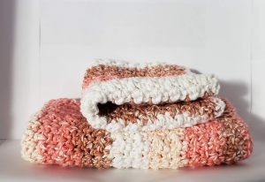 Multicolored crocheted dishcloth and hand towel set.