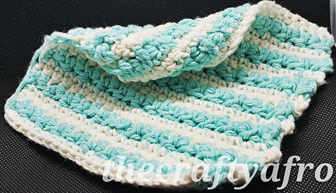 Blue and white crochet dishcloth.