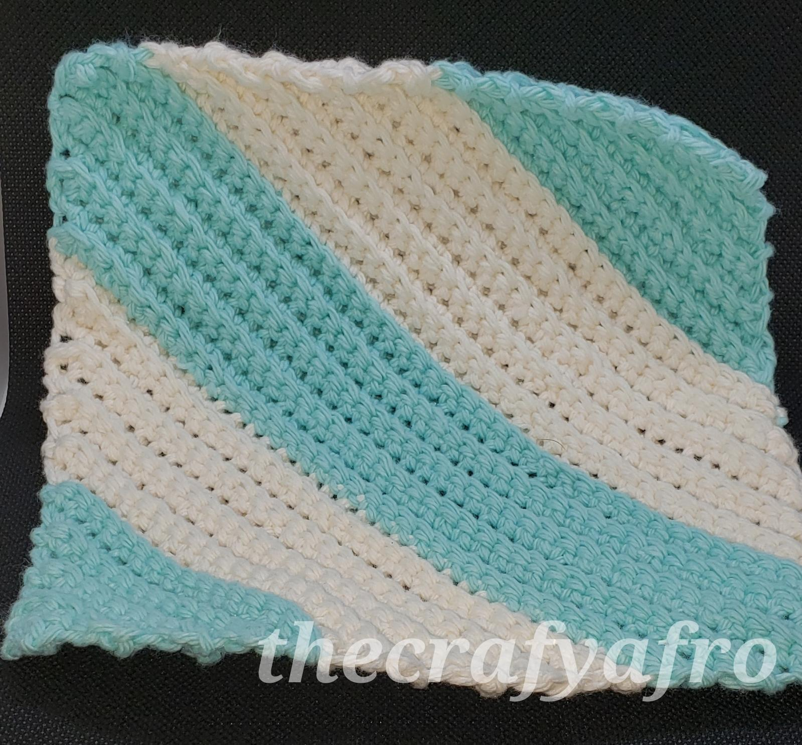 Blue and white striped crochet dishcloth.