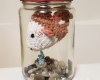 Crochet fish in a jar.
