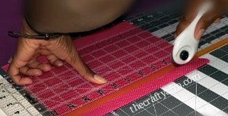 Cutting fabric using the self healing mat, rotary cutter, and ruler.