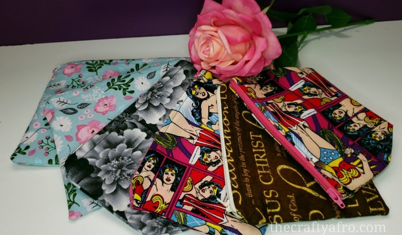 stack of zippered pouches with a pink rose
