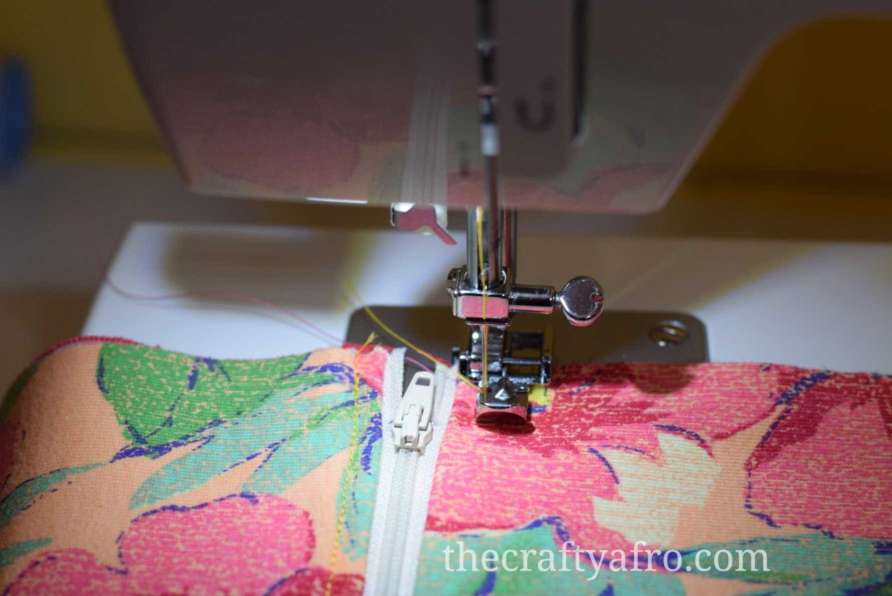 Fabric is placed in the sewing machine to add top stitch.