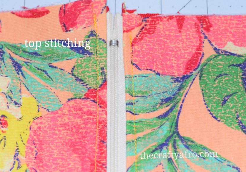 Top stitch on each side of the zipper.