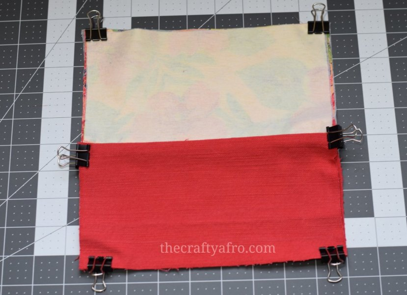 Edges of the fabric are clipped together with binder clips.