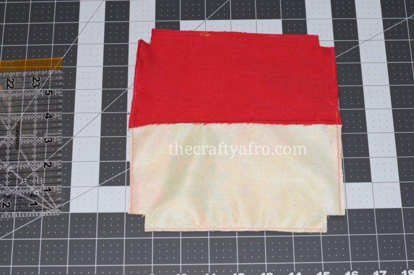 Trim the excess fabric and cut out the boxes of the pouch.