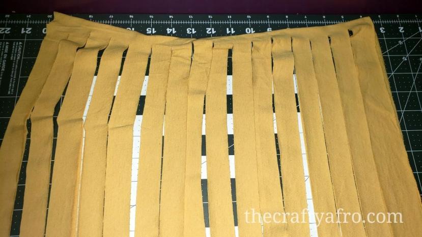 Cut strips of yellow fabric.